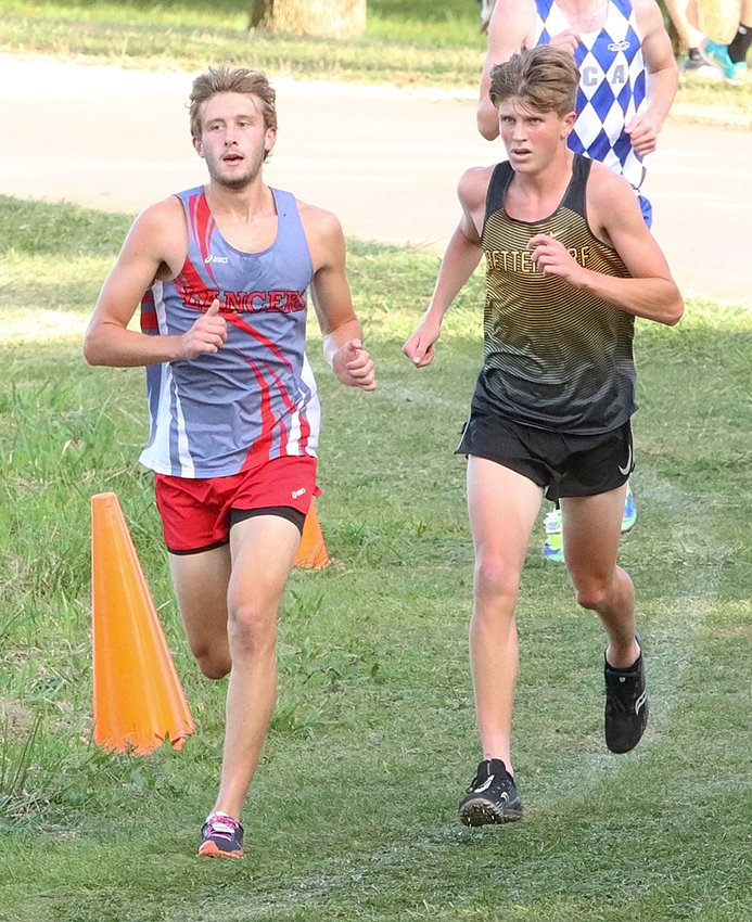 NS senior Luke Crawford battled step-for-step with Bettendorf's Chase Wakefield.