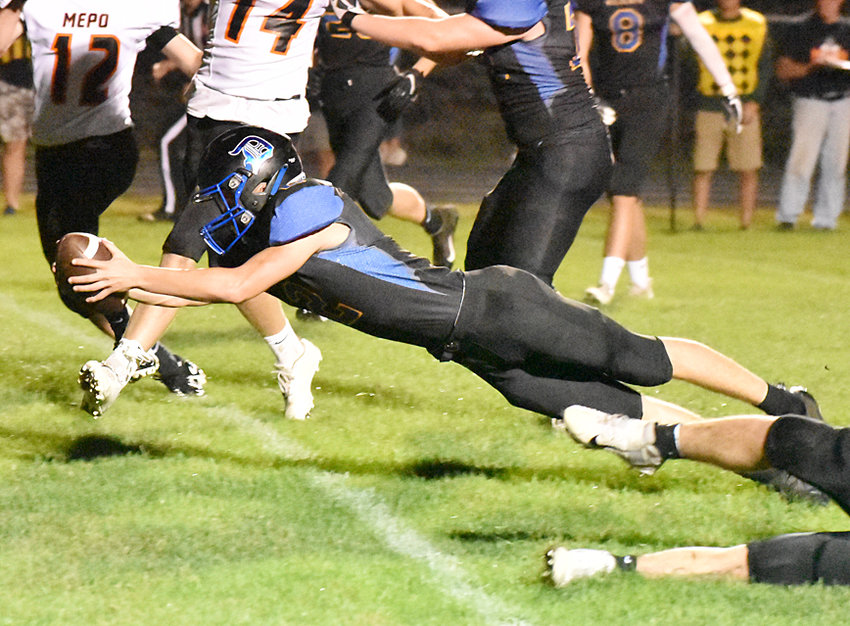 Durant quarterback Charlie Huesmann dives over the goal line for a touchdown at home against Mediapolis Oct. 8. The Wildcats defeated the Bulldogs 18-7, to move into fourth place in Class 1A District 5.