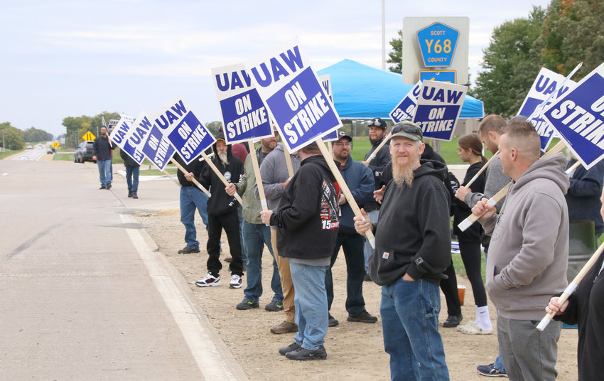 Deere employees picket outside the Davenport plant entrance Friday. Pickets remain around the clock.