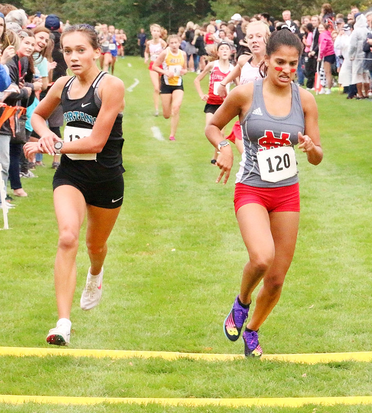 Faith Nead just nipped Pleasant Valley sophomore Josie Case as the line to claim a fifth-place finish at last week's district meet.
