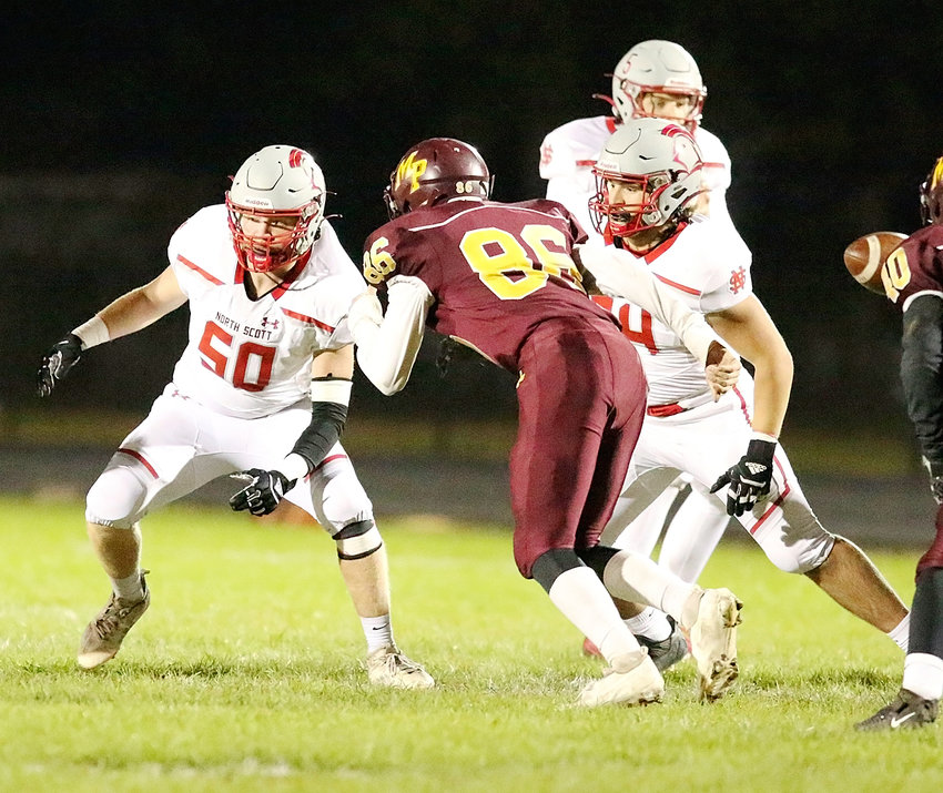 Hunter Kaufman (50) and Braxton Townsley have their eyes on Panther defenders.