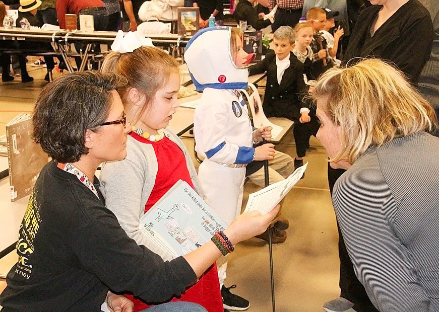 "Parents and other family members were invited to view the ""wax museum"" figures come to life."