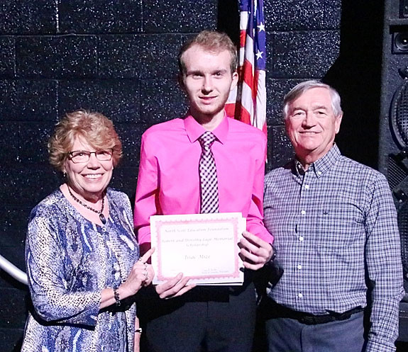 Jane and Rich McCurdy presented the first $4,000 Robert and Dorothy Lage Memorial Scholarship to Isaac Mize.