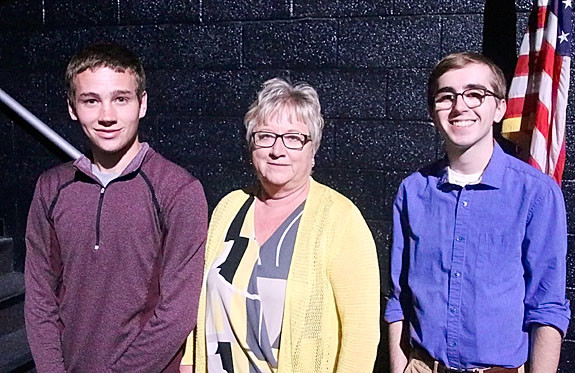 NSEF board member Debbie Shannon presented $2,500 Porter-Robinson Family Scholarships to Travis Doty (l) and Charleston Balsar.