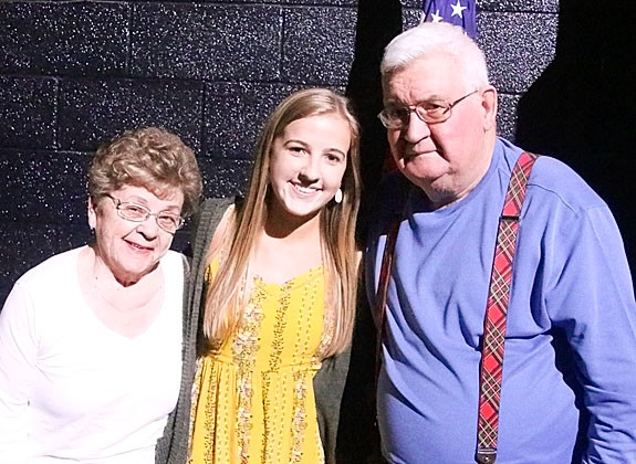 Erin Gehrls was awarded the $1,000 Makenzie Tank Memorial Scholarship. She's pictured with her grandparents, Ken and Annette Tank.