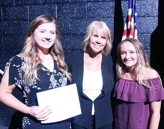 NSEF board member Tracy Lindaman presented $750 Wilma Zabel Memorial Scholarships to Madalyn Latham and Madison Case.