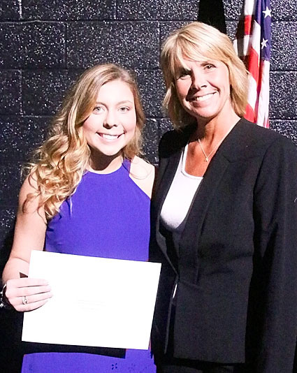 NSEF board member Tracy Lindaman presented the $2,800 North Scott Science Faculty Scholarship to Sofia Hawley.