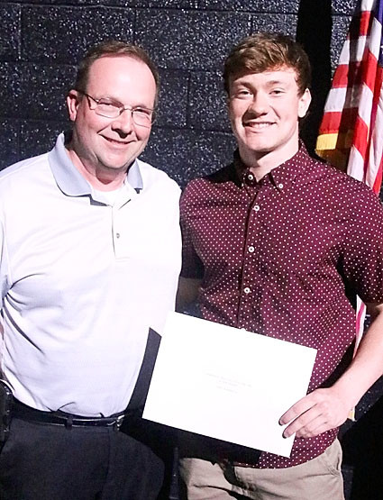 Karl Christoff presented the $1,100 Christoff-DeBiose Health Care Scholarship to Tony Barreca.