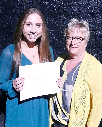 NSEF board member Debbie Shannon presented the $250 Judith Jacobs Performing Arts Scholarship to Madison Bergman.