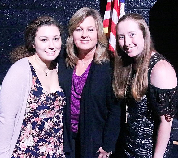 NSEF board member Susan Blaskovich presented $500 Charlotte Mohr Scholarships to Alyssa Schnoor (l) and Jessica Irving.