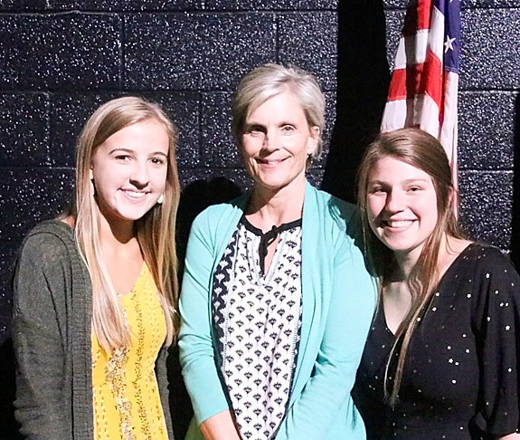 "NSEF board member Kathy Kilen presented $2,250 ""Bear"" Stevens Memorial Scholarships to Erin Gehrls (l) and Reed Smith."
