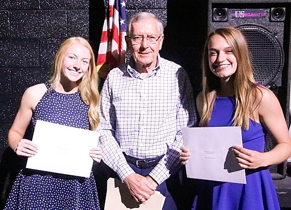 NSEF board member Randy Siemsen presented $3,500 Mickey McArthur Memorial Scholarships to Kendal Newman (l) and Brittany Bullock.