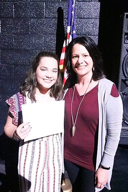 Laura Wiley presented the $1,000 Mike Richlen Memorial Scholarship to Megan Wilmott.