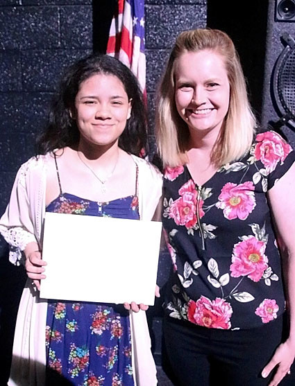 Lindsey Cobie presented the $500 Arline Darland Music Scholarship to Ivy Jensen.