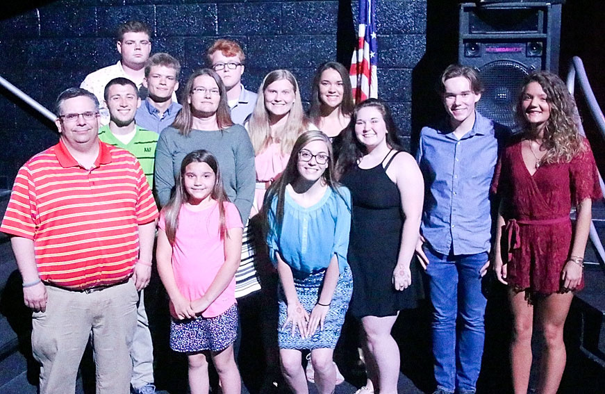 Ten North Scott seniors were awarded $250 Ambrose Kearney Memorial Scholarships, as Ambrose, who died in 2007, would have been a member of the Class of 2018. Pictured (l-r) are Bill Kearney, Jaden Boley, Taylor Hendricksen, Cale Bowe, Nicole Kearney, Memphis Kearney (front), Ben Stutting, Bailey Tague, Brylee Blanchard, Alexis Ernst, Rachel Lee, Keegan Harry and Olivia Otte.
