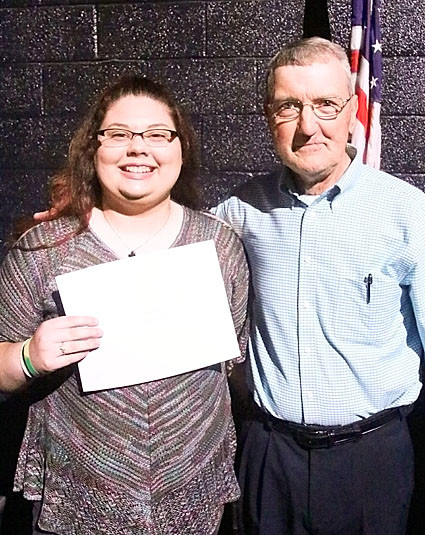 Joe Gross presented the $500 PFLAG Scholarship to Isabella Whitcomb.