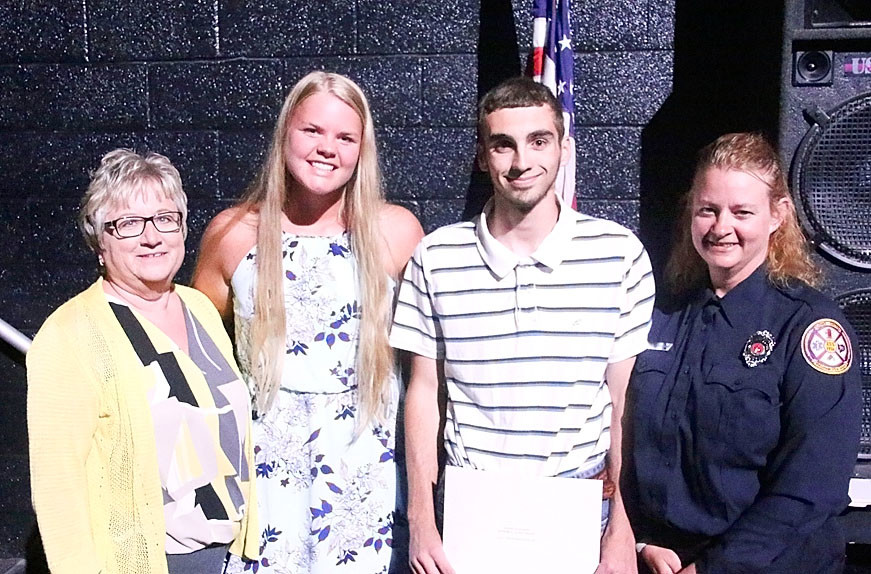 Debbie and Amy Shannon  presented $500 Dennis Shannon Memorial Scholarships to Kora Nagle and Clayton Schoenthaler.