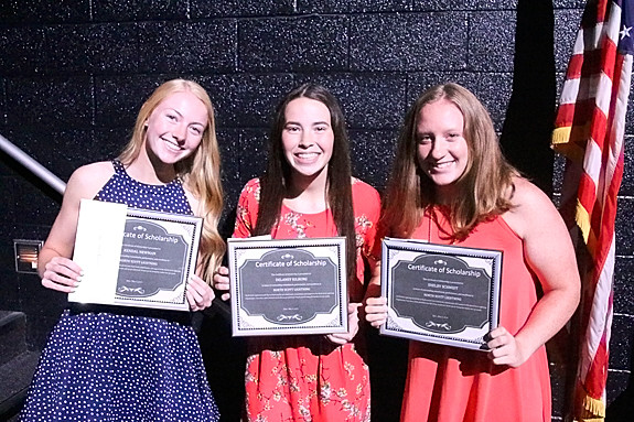 Kendal Newman, Delaney Kilburg and Shelby Schmidt were presented with North Scott Lightning Scholarships.