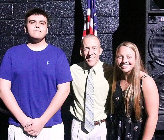 Shane Knoche (center) presented Long Grove Lions Club Scholarships to Alfonzo Bojorquez and Kamryn Luett.