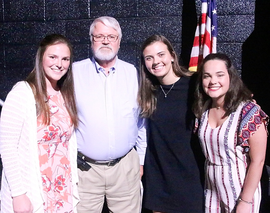 Tom Andresen presented North Scott Kiwanis Club Scholarships to (l-r) Heather Hoeger, Aly Cuppy and Megan Wilmott.