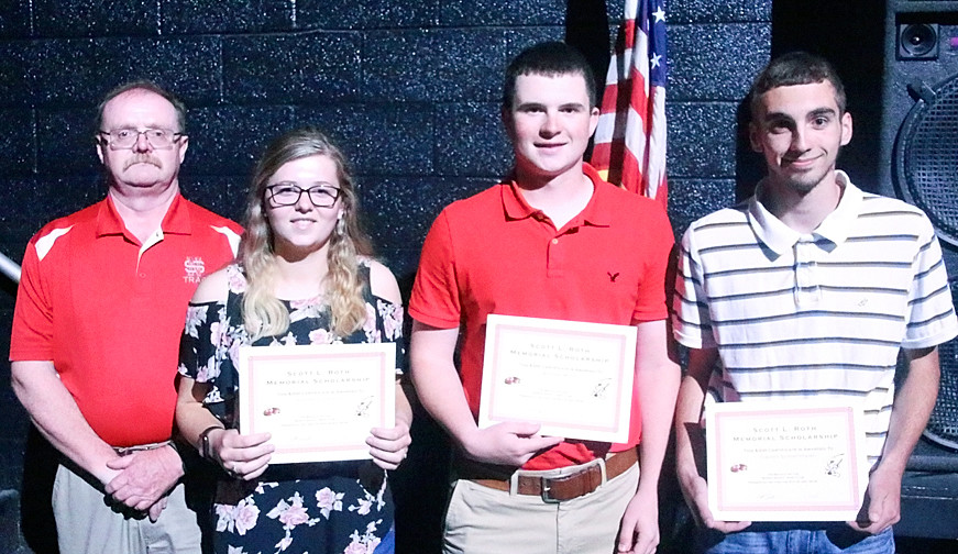 Scott Roenfeldt, on behalf of the North Scott Trapshooting Club, presented Scott R. Roth Memorial Scholarships to Sydney Cronkleton, Michael Mohr and Clayton Schoenthaler. Not pictured are Zach Howes and Eric Long.