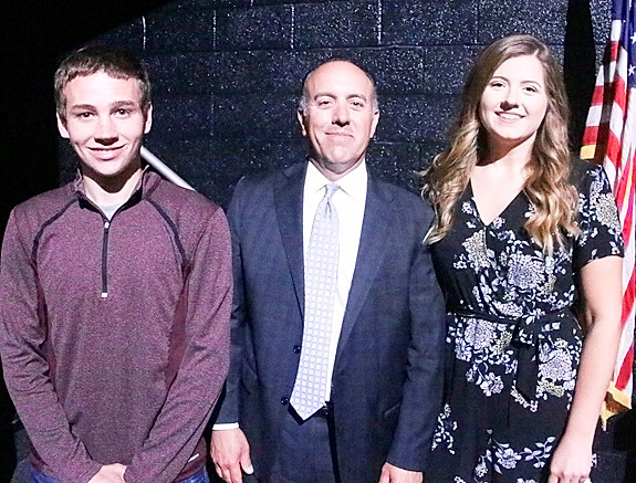 Judge Henry Latham (center) presented North Scott Soccer Club Scholarships to Travis Doty and Madalyn Latham.