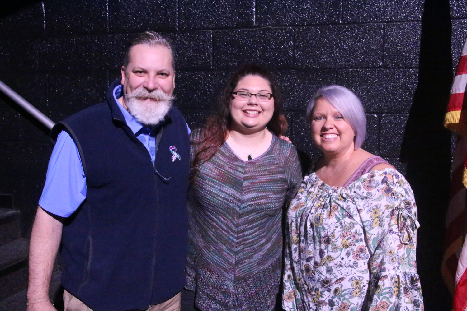 Kevin and Jaime Atwood presented Isabelle Whitcomb with the $1,000 Foster's Voice Scholarship.
