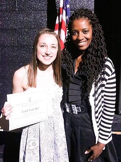 Jasmine Bozeman (r) presented Leah Van Hal with the $100 National Council on Youth Leadership Scholarship.