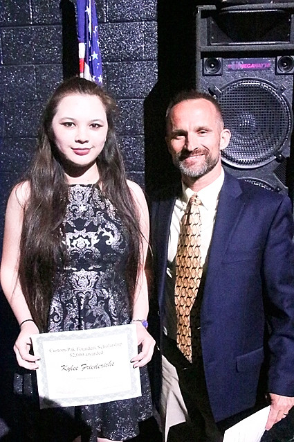 Ron Zimmer presented Kylee Friederichs with the $1,000 Custom-Pak Founders Scholarship.