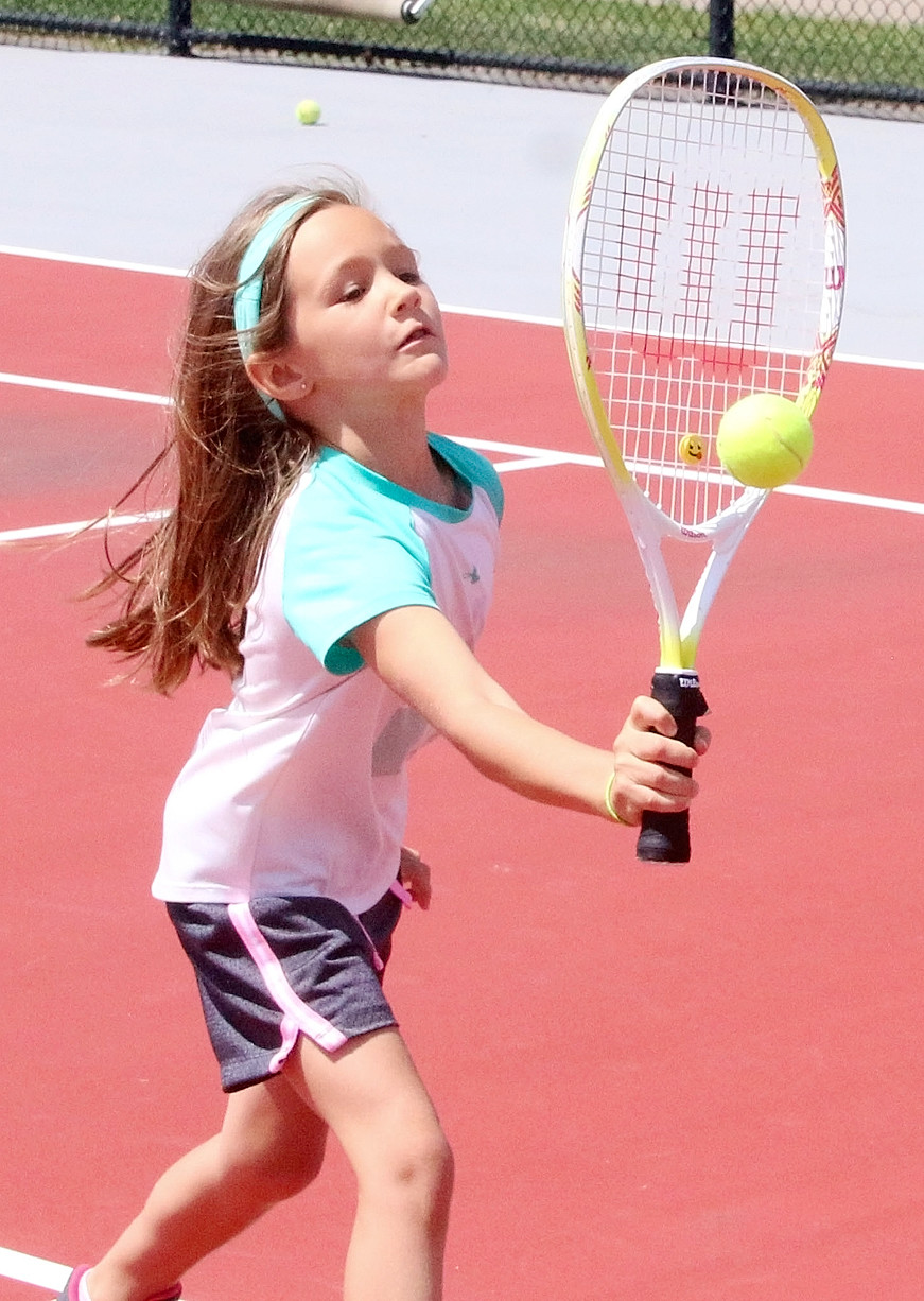 Claire Jepsen works on volleying at the net during the tennis portion of the camp.