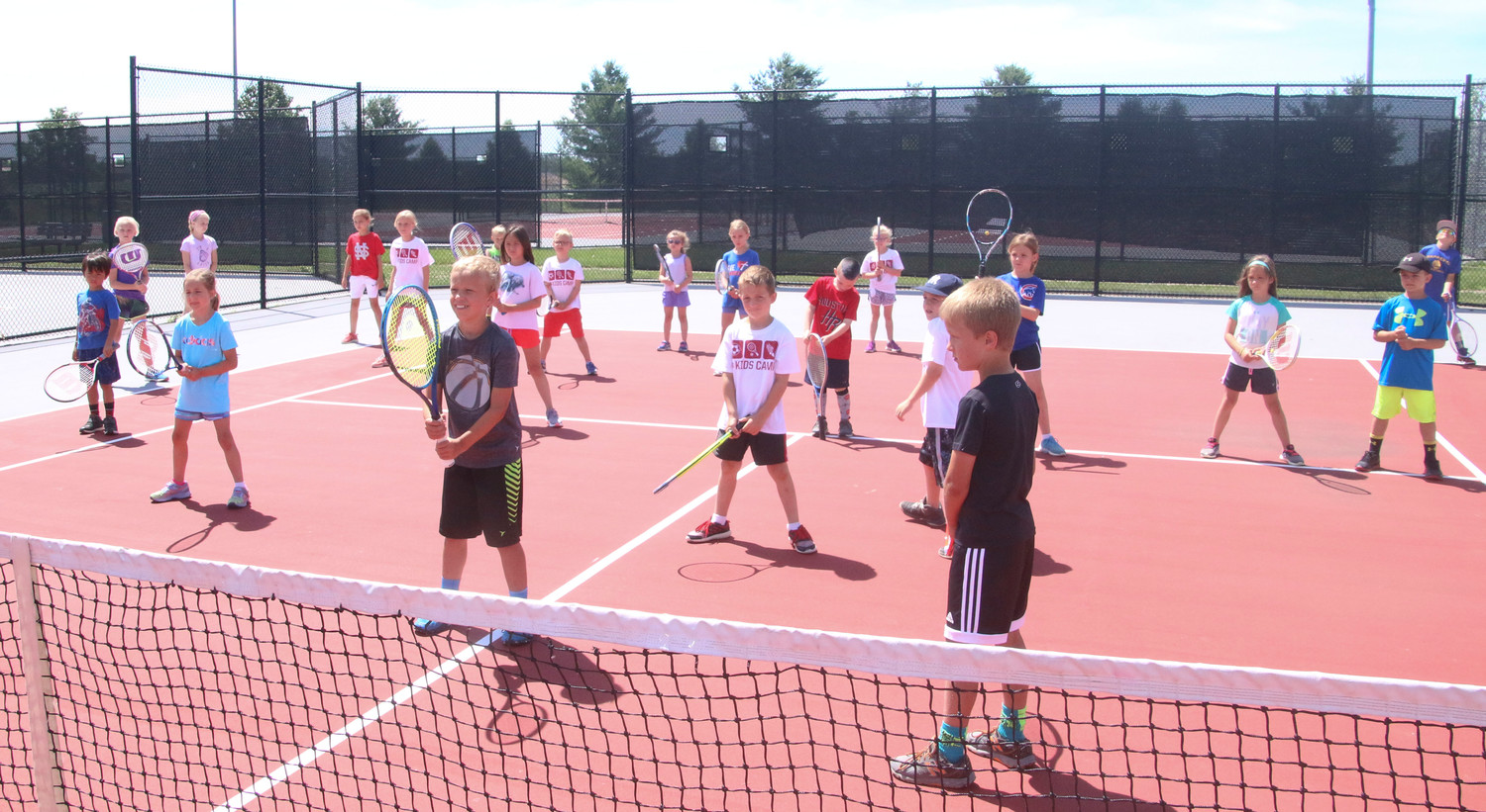 Students entering first thru fifth grade learned the basic fundamentals of track, soccer and tennis under the guidance of Lancer coaches and varsity athletes.