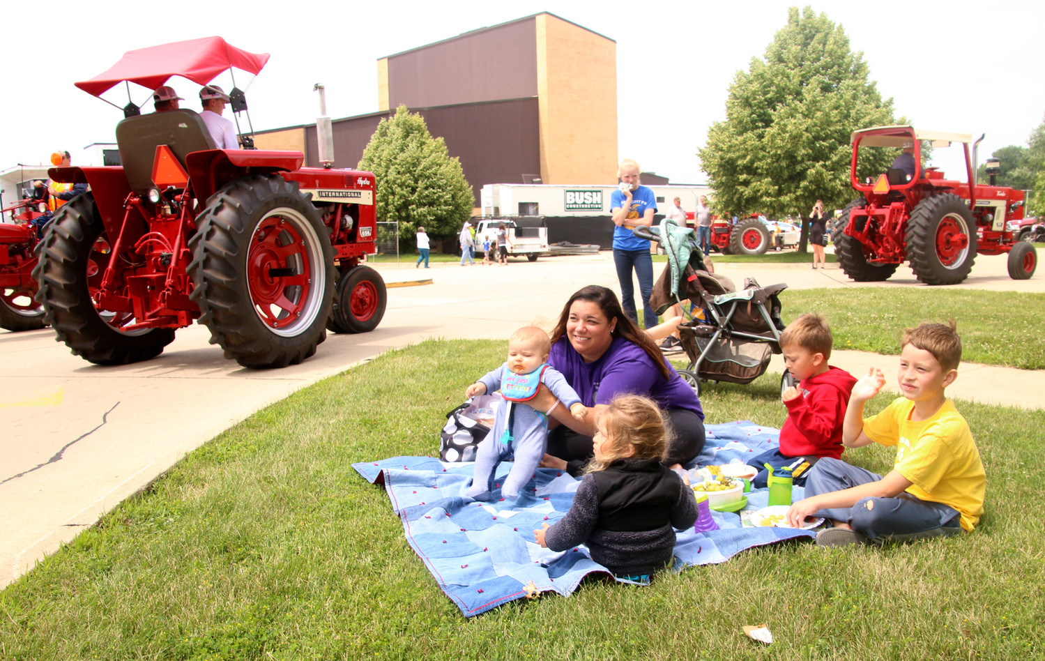Nanny Nicole Thorington, of Davenport, brought the Brooks children, of Eldridge to watch the tractor parade at North Scott High School. The kids are: Tristen, 8, Ryder, 5, Abby, 3 and Dexter, eigtht months.