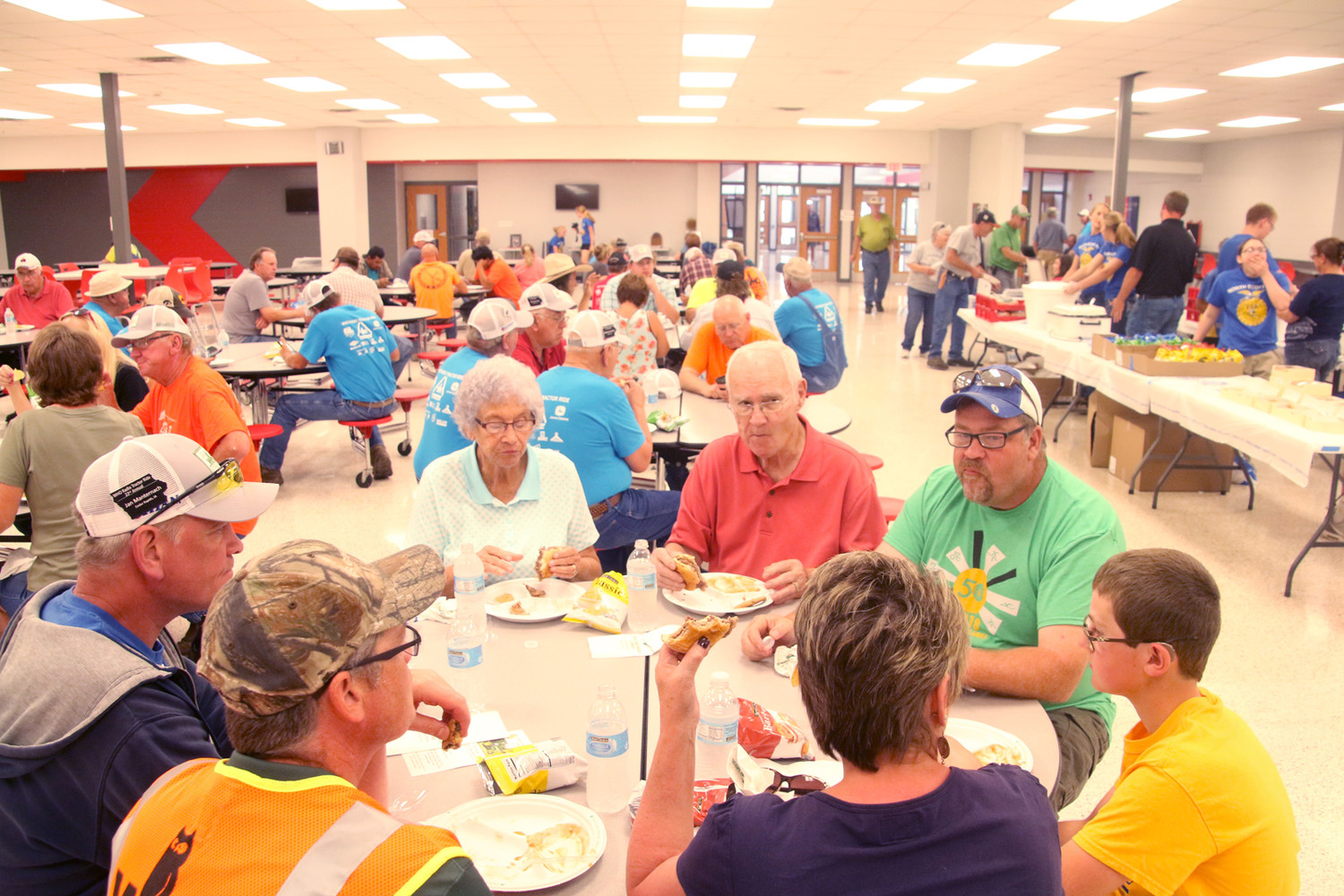 Participants in the 2018 WHO Tractor Ride enjoy rib eyes and a meal served by FFA members and volunteers, Monday, June 25.