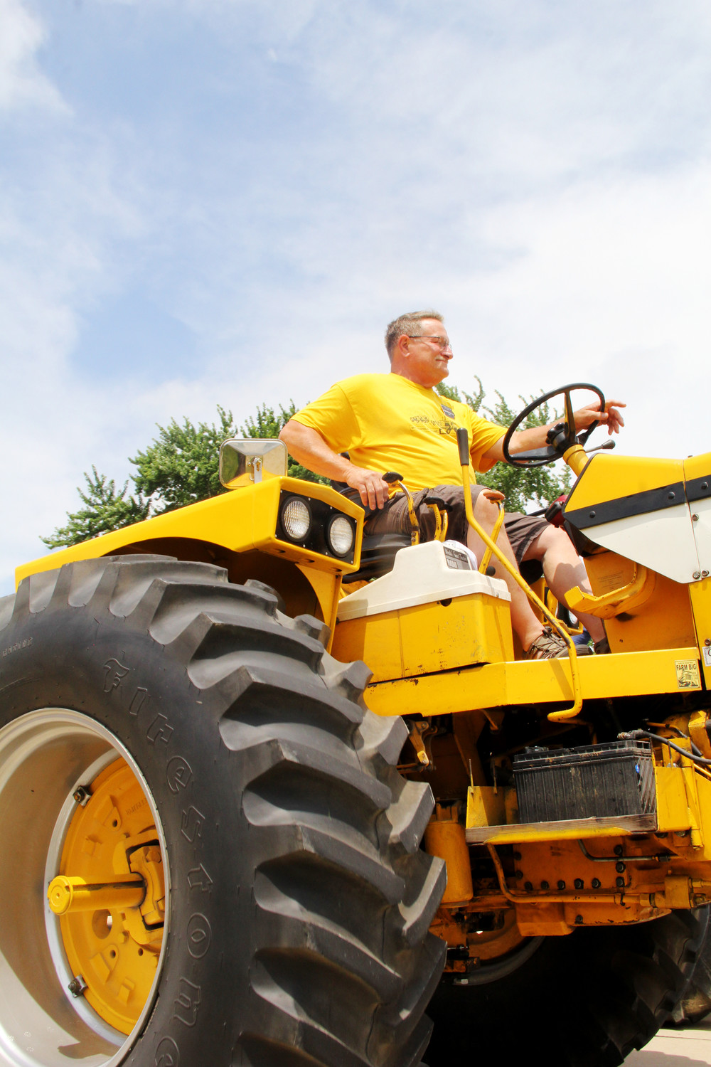 A participant in the June 25, 2018, WHO Tractor Ride leaves North Scott High School.