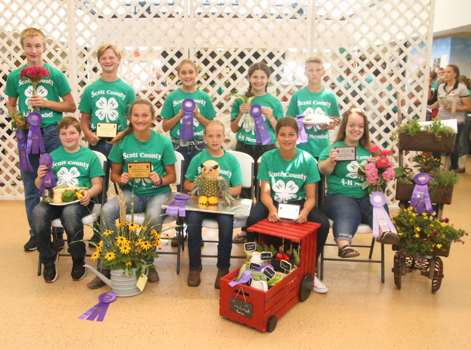 Earning Champion ribbons in the Horticulture Show were these 4-H'ers. Left:  Front (l-r):  Cael Mess, Claire Westendorf, Megan Musal, Sydney Westendorf and Lauren Lanum. Back: Aiden Mess, Bram Mess, Lainey Wall, Elizabeth Ziolkowski and Colton Pilgrim.