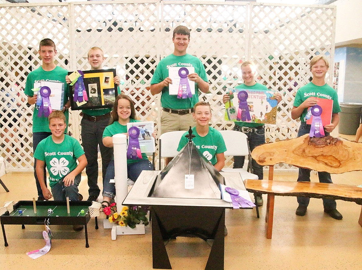 These Scott County 4-H'ers will be displaying their Science, Mechanics and Agriculture projects at the State Fair. Front (l-r): Bryce Daufeldt, Lauren Lanum and Nolan Engelbrecht. Back: Zach Paustian, James Hepler, Ethan Hornbuckle, Fayeth Henningsen and Bram Mess.