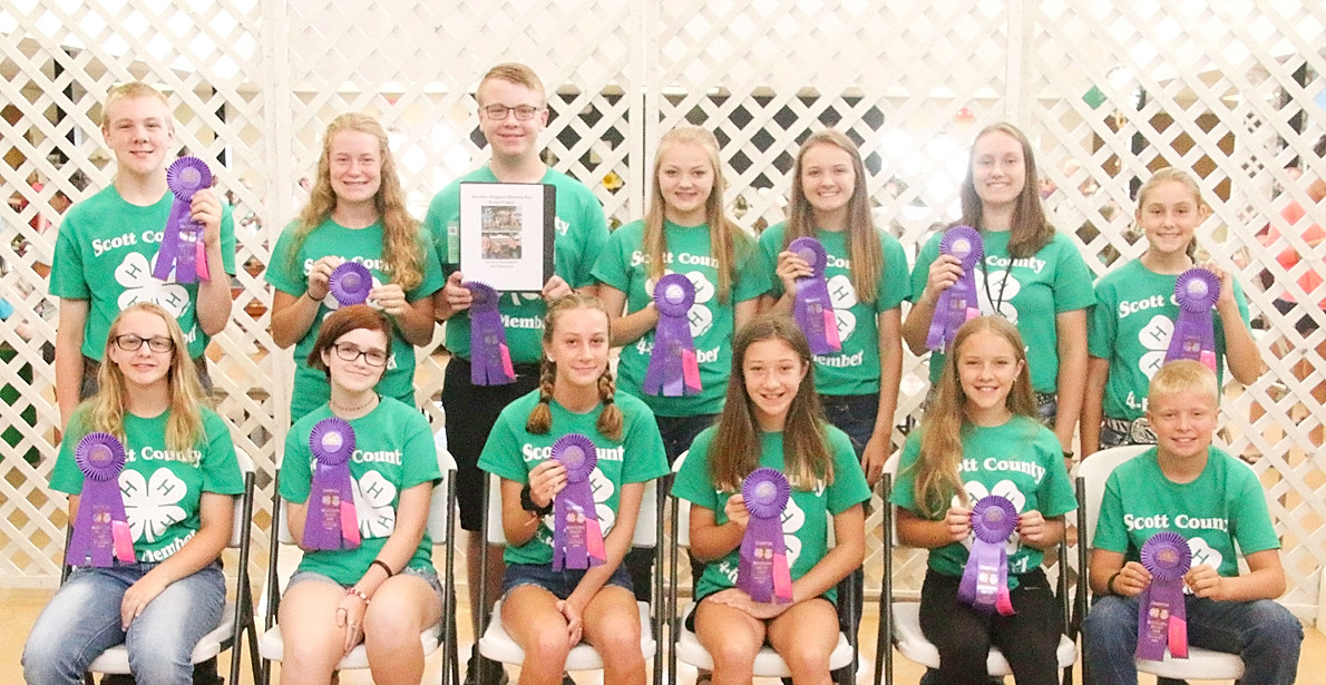 "The Sheridan Sluggers will be taking their ""Blessing Box"" Citizenship project to the State Fair. Front (l-r): Michelle Hepler, Marissa Carlton, Lily McCaw, Sydney McCaw, Courtney Nelson and Maverick Wulf. Back: James Hepler, Grace Bjustrom, Dylan Engelbrecht, Caelan Engelbrecht, Chloe Engelbrecht, Lauren Wall and Lainey Wall."