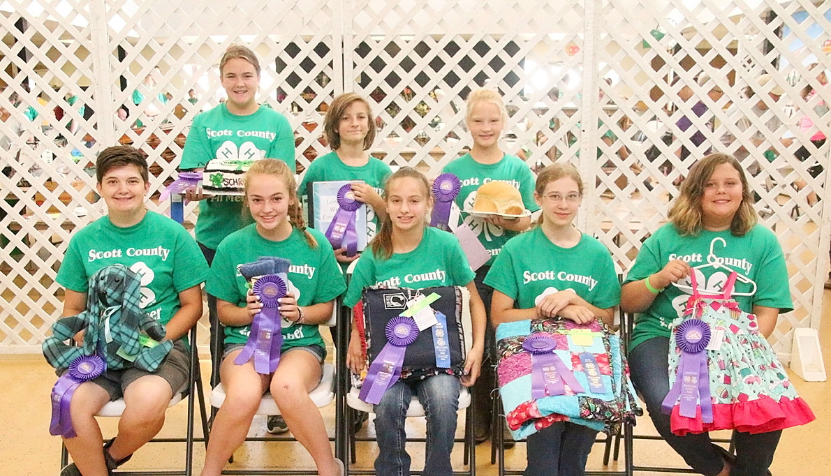 Earning Champion ribbons for their Clothing and Food & Nutrition projects were, front (l-r): Grace Thurber, Caleigh Schlichte, Isabella Buesing, Hailey Ramp and Jayda Denger. Back: Lauren Schroeder, Reuben Leveridge and Greta Brus.