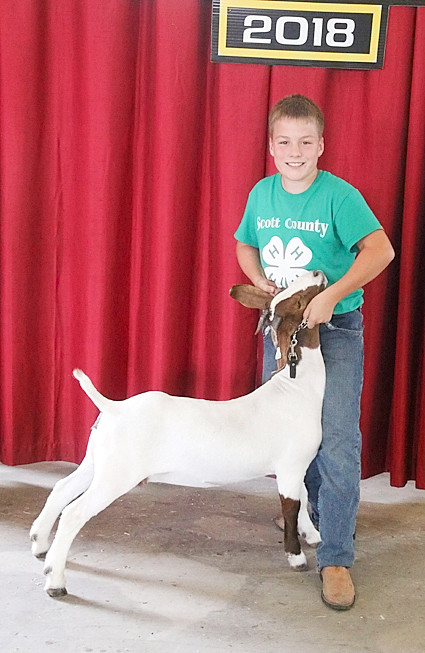 Bryce Daufeldt showed the Reserve Champion Meat Goat.