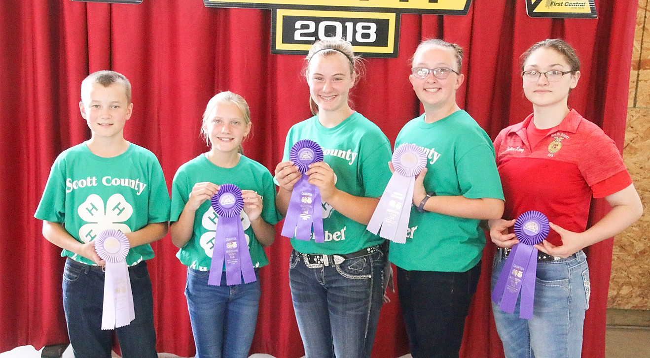 Taking top honors in the 4-H Market Sheep Showmanship competition were (l-r): Blake Daufeldt (Jr. Reserve), Kylie Klindt (Jr. Champion), Fayeth Henningsen (Int. Champion), Kaitlin Kiefer (Int. Reserve) and Caelan Long (Sr. Champion).