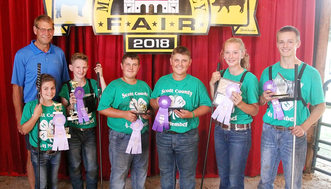 Taking home Showmanship honors in the Market Steer Show were (l-r): McKenna DeCap (Jr. Reserve), Dawson Book (Jr. Champion), Brock Benson (Int. Reserve), Brandon Benson (Int. Champion), Coryn Wilson (Sr. Reserve) and Kody Koberg (Sr. Champion). Pictured with them is Lonnie Sievers.