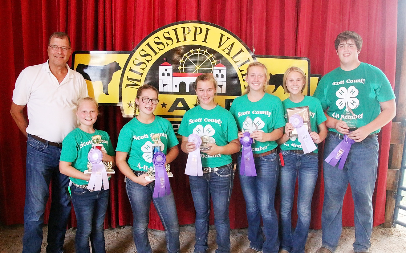 Taking home Showmanship honors in the Swine Show were (l-r): Brooklyn Flenker (Jr. Reserve), Kennedy Jehle (Jr. Champion), Fayeth Henningsen (Int. Reserve), Kylie Schult (Int. Champion), Kira Schult (Sr. Reserve) and Joe Lilenthal (Sr. Champion). They are pictured with Mike Hein of Liberty Trust & Savings Bank.