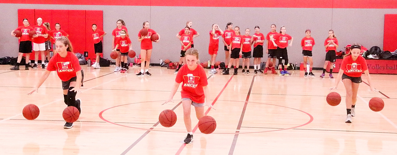 Campers spent a lot of time working on fundamentals, and honing their dribbling skills during this drills were (l-r) Rylee Daniels, Ryenne Lacher and Ruby Bohr.