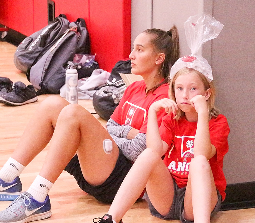 Taking a break in the action were North Scott senior-to-be Rylie Rucker and Madelyn Slate.
