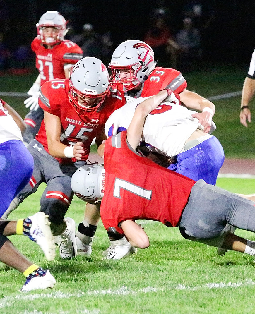 Lancer seniors Collin Lewis (7), Cade Akers (15) and Garrett Willey teamed up to bring down Central running back Carlos Terrell.