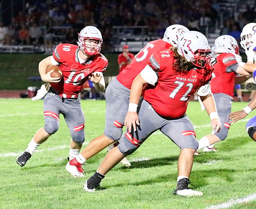 With Antonio Bojorquez (72) and Jackson Stoefen (55) leading the way, quarterback Nile McLaughlin looks for an opening in the Central defense.