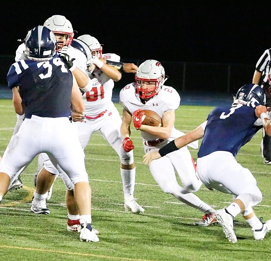 Jacob Porth finds a hole in the Spartan defense.