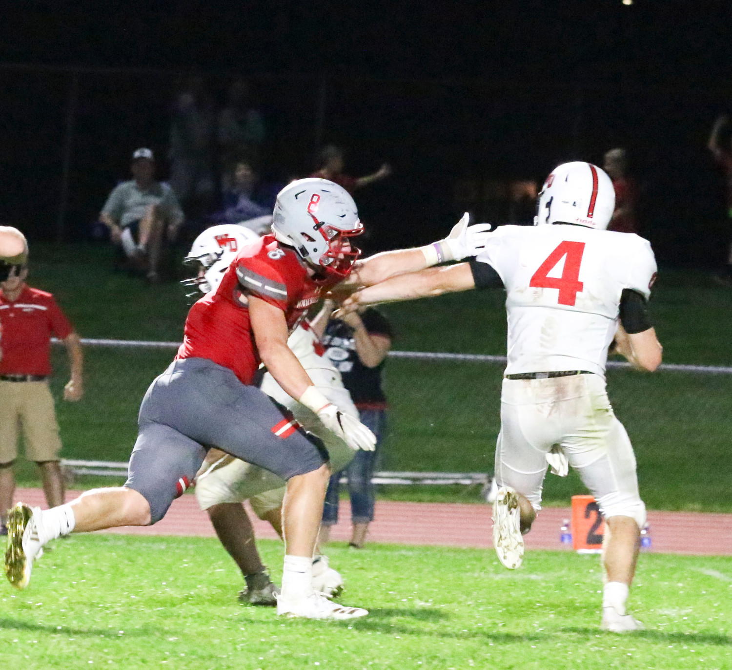 Ben Belken runs down Western Dubuque quarterback Calvin Harris.