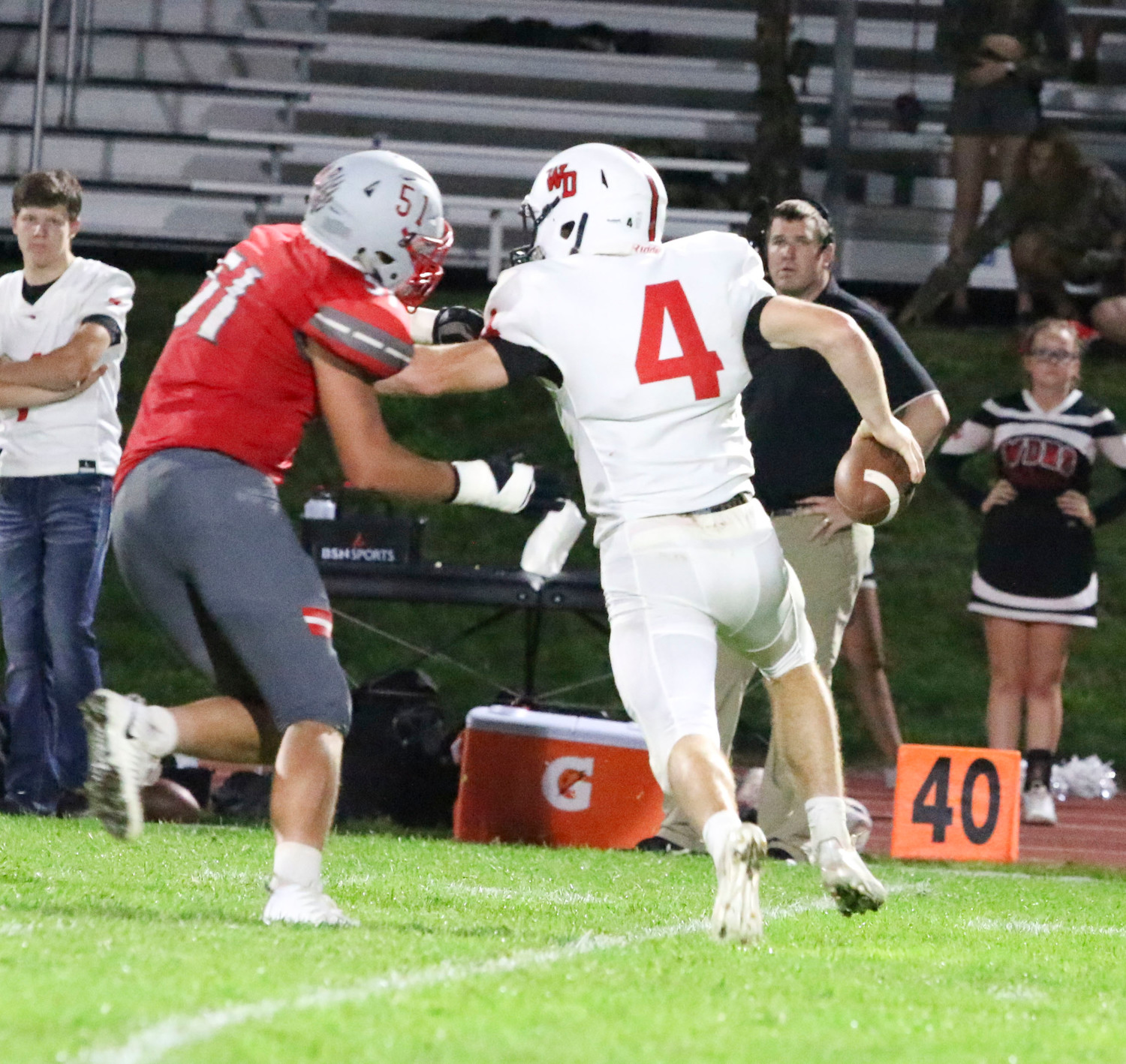 Gabe Stricker pressures Western Dubuque quarterback Calvin Harris.
