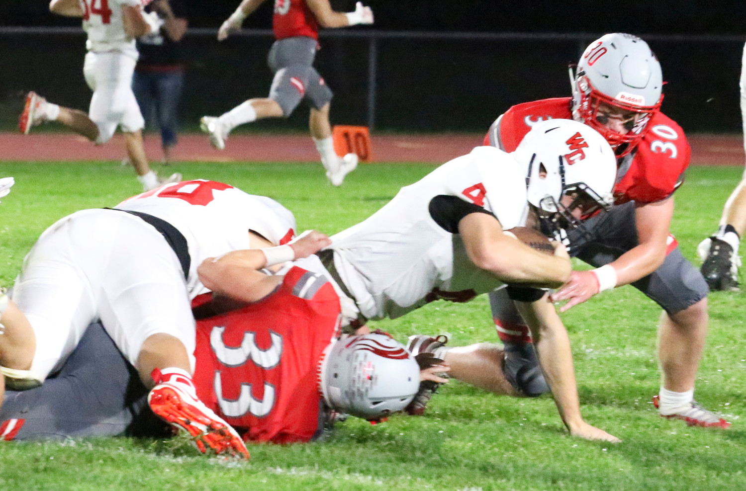 Garrett Willey and Sam Erickson bring down Western Dubuque quarterback Calvin Harris.